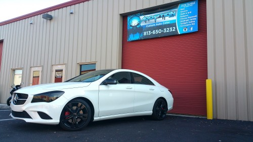 Customers car parked outside of our shop showing off their new Gloss Black Rims and Roof Wrap, Red Calipers and Tinted Headlights