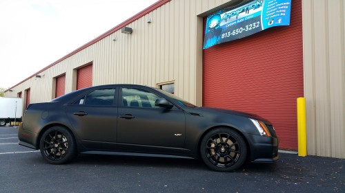 Our customers Cadillac in front of our Tampa Shop showing off their new Black Wrap and Gloss Black Rims