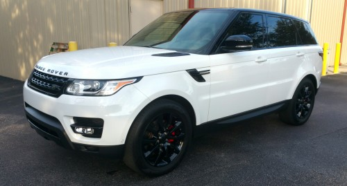 Gloss Black: Rims, Mirrors, Emblems, Vents and Trim. Painted Red Brake Calipers - Range Rover